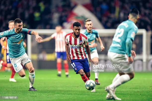 Thomas Lemar and Oier during La Liga match between Club Atletico de Madrid and CA Osasuna at Wanda Metropolitano on December 14 2019 in Madrid Spain
