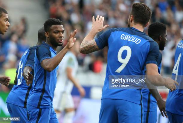 Thomas Lemar and Olivier Giroud of France celebrate the goal of Samuel Umtiti during the international friendly match between France and England at...