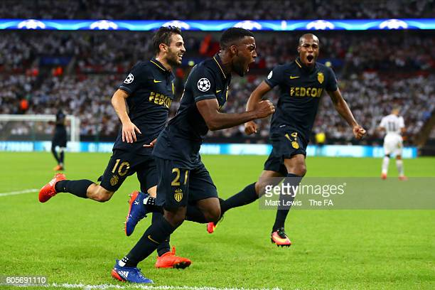 Thomas Lemar of AS Monaco runs off in celebration with team-mates Bernardo Silva and Djibril Sidibe during the UEFA Champions League match between...