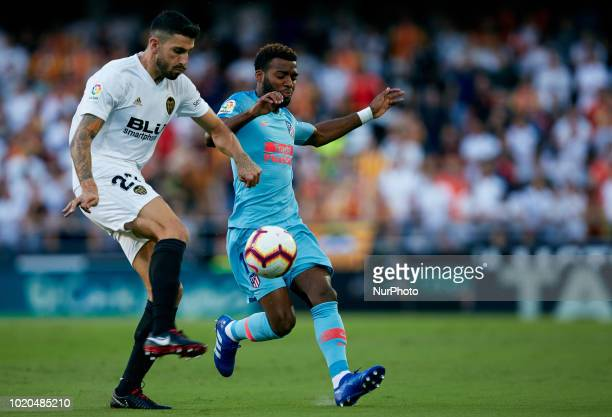 Thomas Lemar of Atletico de Madrid competes for the ball with Cristiano Piccini of Valencia CF during the La Liga match between Valencia CF and Club...