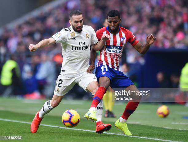 Thomas Lemar of Atletico Madrid battles for possession with Daniel Carvajal of Real Madrid during the La Liga match between Club Atletico de Madrid...