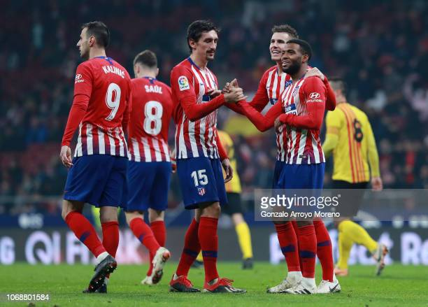 Thomas Lemar of Atletico Madrid celebrates with team mates after scoring his team's first goal during the Copa del Rey fourth round second leg match...