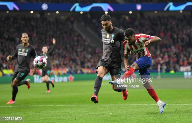 Thomas Lemar of Atletico Madrid shoots as he is challenged by Joe Gomez of Liverpool during the UEFA Champions League round of 16 first leg match...