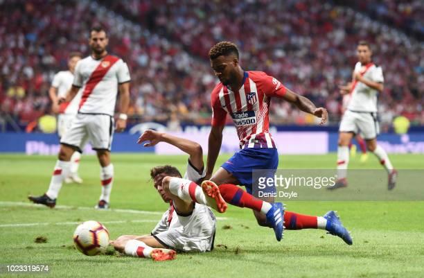 Thomas Lemar of Club Atletico de Madrid is challenged by Gorka Elustondo Urkola of Rayo Vallecano de Madrid during the La Liga match between Club...