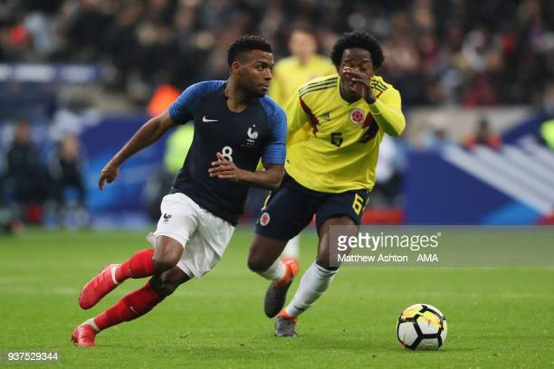 Thomas Lemar of France and Carlos Sanchez of Colombia during the International Friendly match between France and Colombia at Stade de France on March...