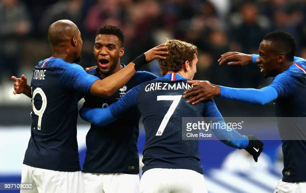 Thomas Lemar of France celebrates with teammates after scoring his sides second goal during the International friendly match between France and...