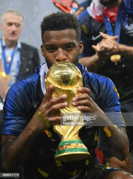 Thomas Lemar of France celebrates with the World Cup Trophy following his sides victory in the 2018 FIFA World Cup Final between France and Croatia...