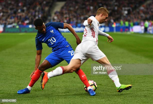 Thomas Lemar of France challenges Gerard Deulofeu of Spain during the International Friendly match between France and Spain at Stade de France on...