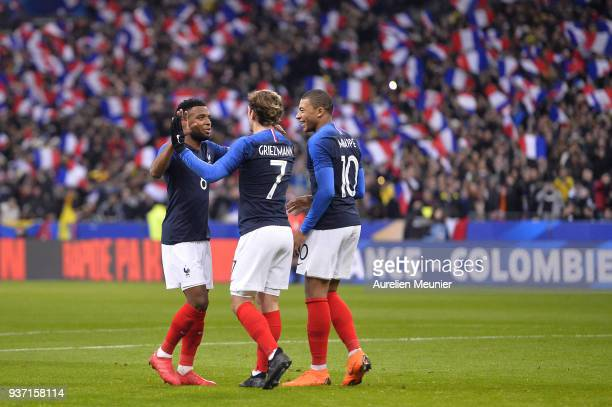 Thomas Lemar of France is congratulated by teammates Antoine Griezmann and Kylian Mbappe after scoring during the international friendly match...