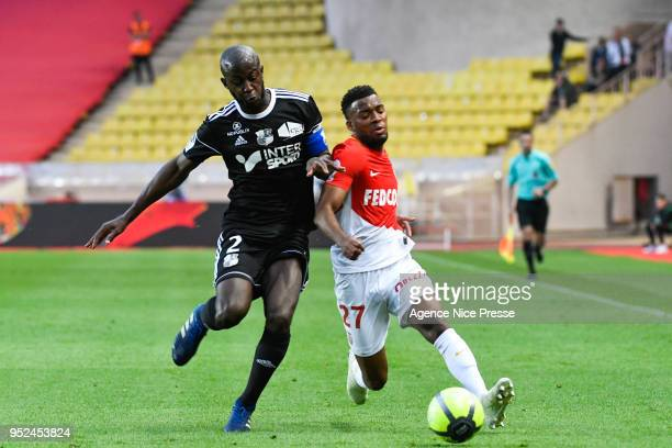 Thomas Lemar of Monaco and PrinceDesir Gouano of Amiens during the Ligue 1 match between AS Monaco and Amiens SC at Stade Louis II on April 28 2018...