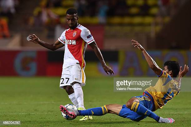 Thomas Lemar of Monaco is tackled by Danilo Barbosa of Valencia during the UEFA Champions League qualifying round play off second leg match between...