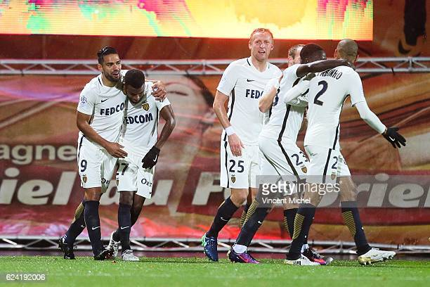 Thomas Lemar of Monaco jubilates with teammates after scoring the second goal during the Ligue 1 match between Fc Lorient and As Monaco at Stade du...