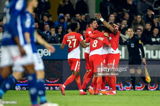 Thomas Lemar Stevan Jovetic Joao Moutinho of Monaco celebrate a goal during the Ligue 1 match between Strasbourg and AS Monaco at on March 9 2018 in...