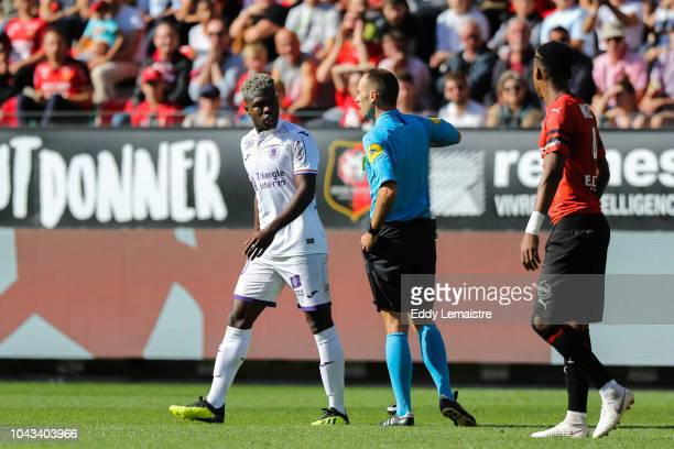 Thomas Leonard referee give a red card at Aaron Leya Iseka of Toulouse during the Ligue 1 match between Rennes and Toulouse at Roazhon Park on...