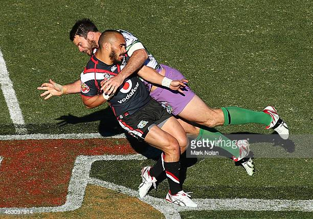 Thomas Leuluai of the Warriors is tackled late by David Shillington of the Raiders during the round 21 NRL match between the Canberra Raiders and the...