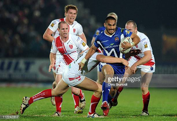 Thomas Leuluai of Wigan Warriors is tackled by Liam Watts of Hull Kingston Rovers during the Engage Super League match between Hull Kingston Rovers...