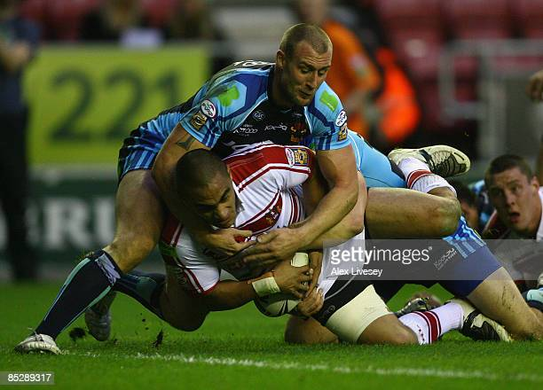 Thomas Leuluai of Wigan Warriors is tackled just short of the try line by Michael Platt of Bradford Bulls during the the engage Super League match...