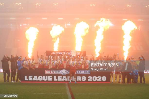 Thomas Leuluai of Wigan Warriors lifts the League Leaders' Shield in celebration with team mates after the Betfred Super League match between Wigan...