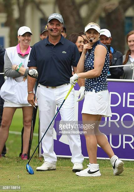 Thomas Levet of France and Carly Booth of Scotland share a joke during a mixed exhibition match prior to the start of the Trophee Hassan II at Royal...