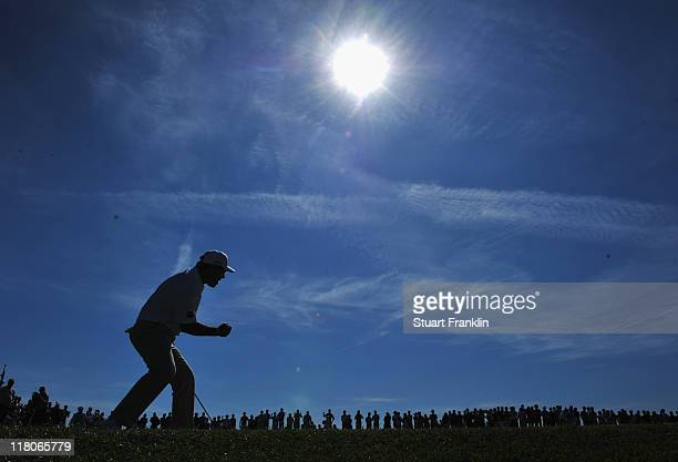 Thomas Levet of France celebrates his putt on the 18th hole during the final round of The Open de France presented by Alstom at the Golf National...