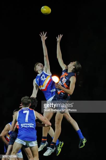 Thomas Lockman of the Eastern Ranges and James Westphal of the Calder Cannons compete for the ball during the round two TAC Cup match between Calder...