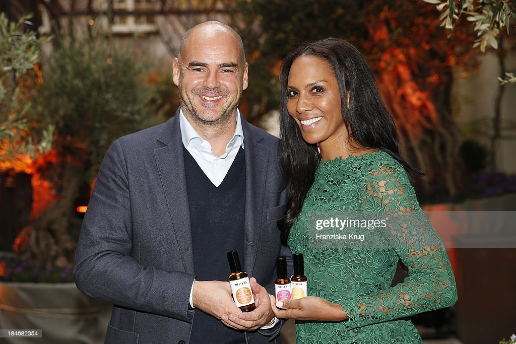 Thomas Lommel and Barbara Becker (Brand Ambassador for OLIVEDA) attend the OLIVEDA Launch Party at Bayerischer Hof on October 15, 2013 in Munich, Germany.