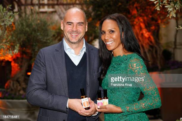 Thomas Lommel and Barbara Becker attend the Oliveda Photocall at Bayerischer Hof on October 15 2013 in Munich Germany