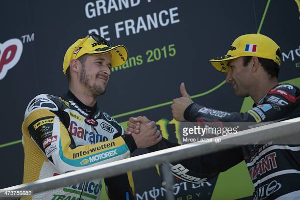 Thomas Luthi of of Switzerland and Derendinger Racing Interwetten and Johann Zarco of French and AJO Motorsport celebrates on the podium at the end...