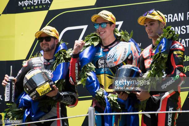 Thomas Luthi of Swiss and Dynavolt Intact GP, Alex Marquez of Spain and EG 0,0 Marc VDS and Jorge Navarro of Spain and +Ego Speed Up celebrate on the...