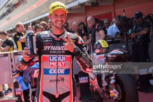 Thomas Luthi of Swiss and Dynavolt Intact GP celebrates at the end of the qualifying practice during the MotoGp of Catalunya - Qualifying at Circuit...