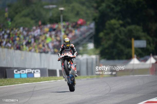 Thomas Luthi of Swiss and Dynavolt Intact GP lifts the front wheel during the Moto2 race during the MotoGp of Italy - Race at Mugello Circuit on June...