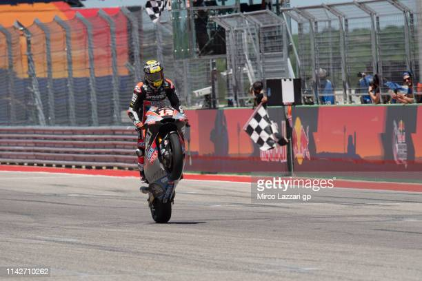 Thomas Luthi of Swiss and Dynavolt Intact GPR cuts the finish lane and celebrates the victory at the end of the Moto2 race during the MotoGp Red Bull...
