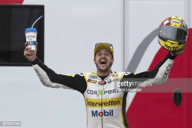 Thomas Luthi of Switzerland and Carxpert Interwetten celebrates the victory on the podium at the end of the Moto2 race during the MotoGp of Czech...