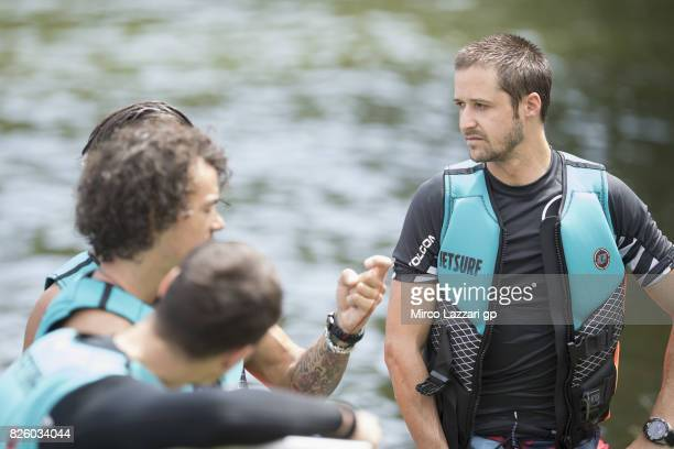 Thomas Luthi of Switzerland and Carxpert Interwetten looks on during the preevent 'Motogp riders make a JetSurf competition at the Brno Dam' during...