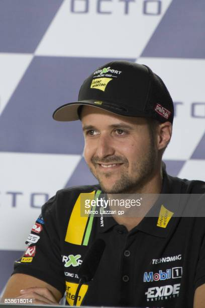 Thomas Luthi of Switzerland and Carxpert Interwetten speaks during the press conference preevent during the MotoGp Of Great Britain Previews at...