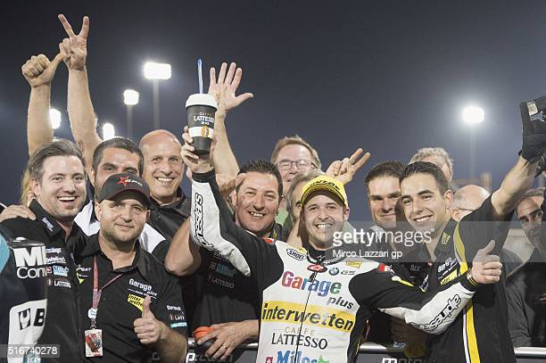 Thomas Luthi of Switzerland and Garage Plus Interwetten celebrates the Moto2 victory under the podium at the end of the Moto2 race during the MotoGp...