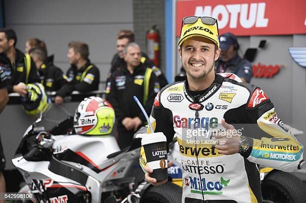 Thomas Luthi of Switzerland and Garage Plus Interwetten celebrates the pole position at the end of the qualifying practice during the at MotoGP...