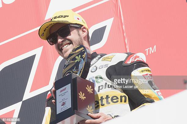 Thomas Luthi of Switzerland and Garage Plus Interwetten celebrates the victory in the podium at the end of the Moto2 race during the MotoGP of Japan...