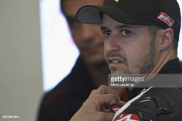 Thomas Luthi of Switzerland and Garage Plus Interwetten looks on in box during the MotoGp of Czech Republic Free Practice at Brno Circuit on August...