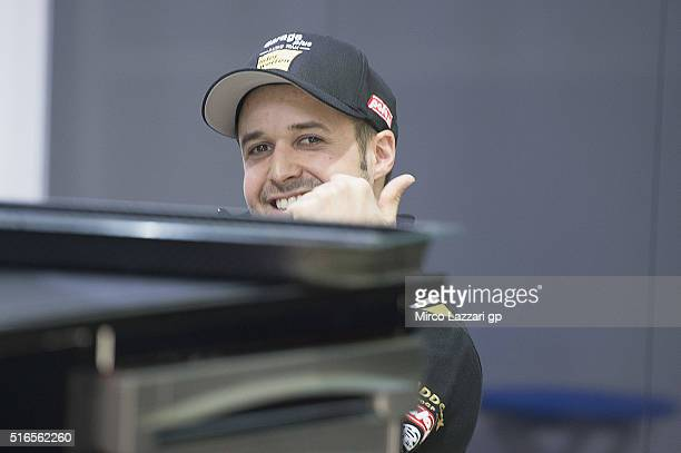 Thomas Luthi of Switzerland and Garage Plus Interwetten smiles in box during the qualifying practice during the MotoGp of Qatar Qualifying at Losail...