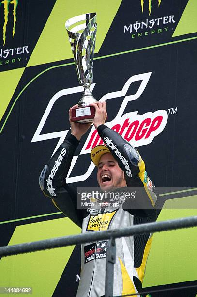 Thomas Luthi of Switzerland and Interwetten Paddock celebrates with the trophy on the podium at the end of the Moto2 race of the MotoGp Of France on...