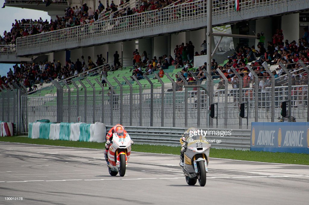 Thomas Luthi of Switzerland and Interwetten Paddock leads Stefan Bradl of Germany and Viessmann Kiefer Racing during the Moto2 race of MotoGP of Malaysia at Sepang Circuit on October 23, 2011 in Kuala Lumpur, Malaysia.