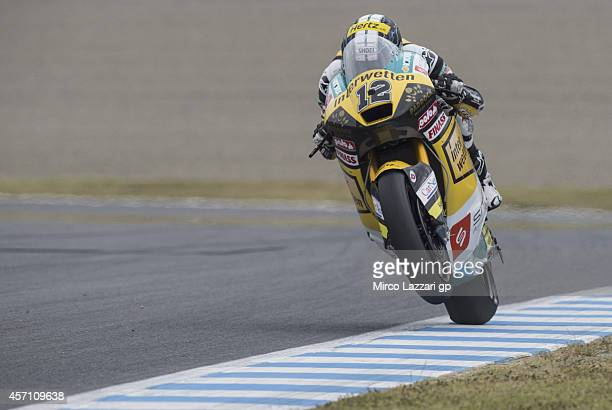 Thomas Luthi of Switzerland and Interwetten Paddock lifts the front wheel at the end of the Moto2 race during the MotoGP Of Japan Race at Twin Ring...