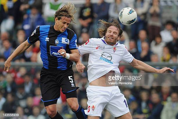 Thomas Manfredini of Atalanta BC goes up with Cesare Natali of ACF Fiorentina during the Serie A match between Atalanta BC and ACF Fiorentina at...