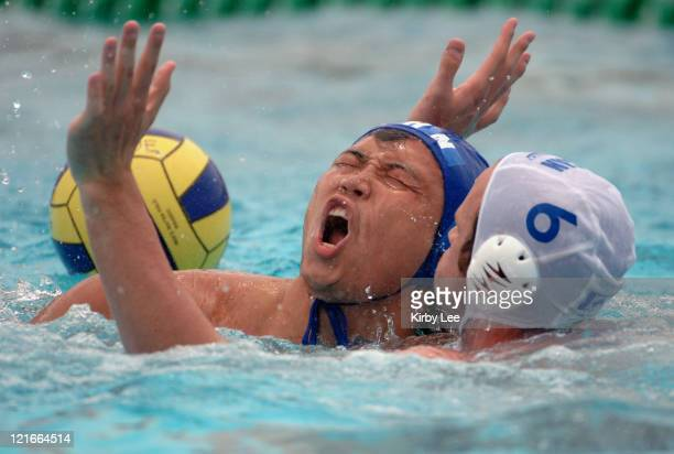 Thomas Marks of Canada defends Lijun Yu of China during FINA World League semifinal at the USA Water Polo National Training Center in Los Alamitos...