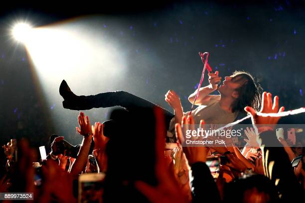 Thomas Mars of Phoenix crowdsurfs during KROQ Almost Acoustic Christmas 2017 at The Forum on December 10 2017 in Inglewood California