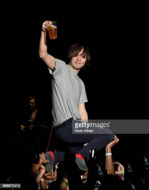 Thomas Mars of Phoenix performs and crowdsurfs during KROQ Almost Acoustic Christmas 2017 at The Forum on December 10 2017 in Inglewood California