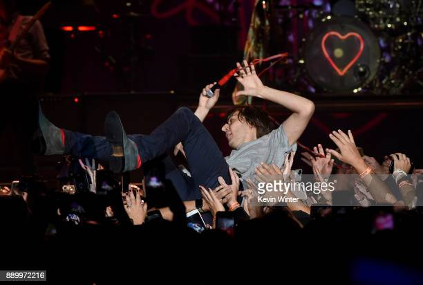 Thomas Mars of Phoenix performs and crowdsurfs onstage during KROQ Almost Acoustic Christmas 2017 at The Forum on December 10 2017 in Inglewood...