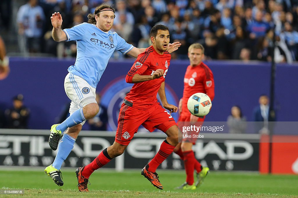 Thomas McNamara #15 of New York City FC and Steven Beitashour #33 of Toronto FC vie for the ball at Yankee Stadium on March 13, 2016 in the Bronx borough of New York City.