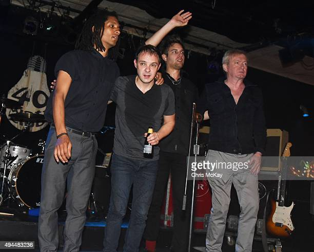 Thomas McNeice Jonny Finnegan John Gaoler Sterry and Andy Gill of Gang Of Four perform at 40 Watt Club on October 26 2015 in Athens Georgia